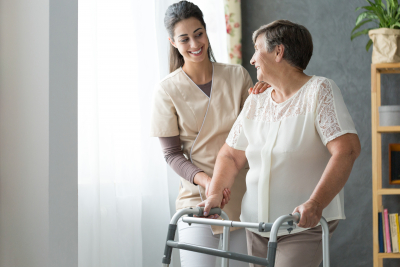 caregiver and senior looking each other