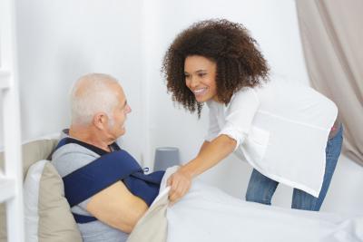 caregiver taking care of the senior man